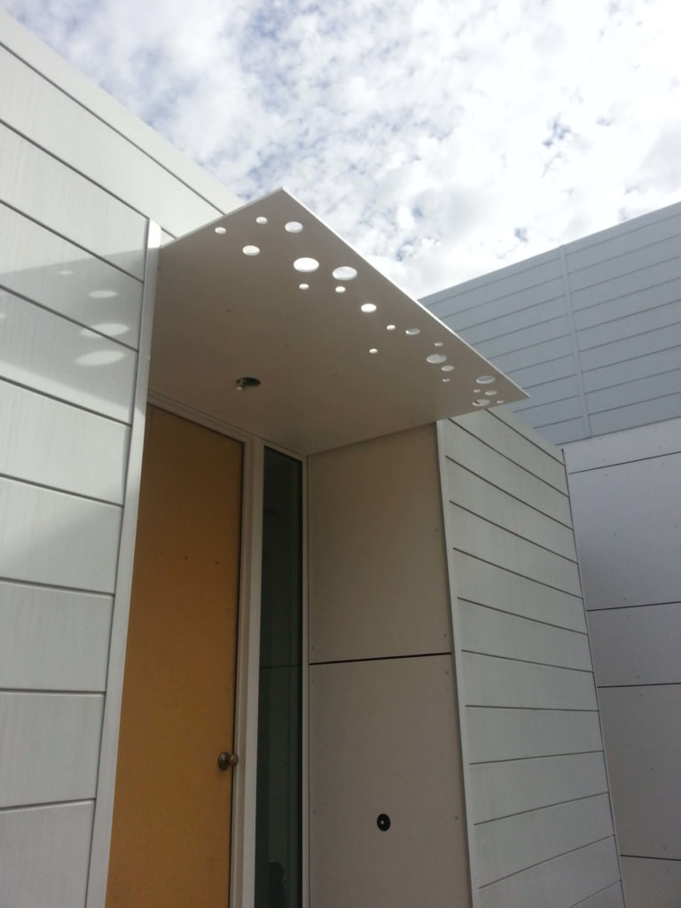Contemporary Fabricated Steel Awning With Circles 2 ENSO