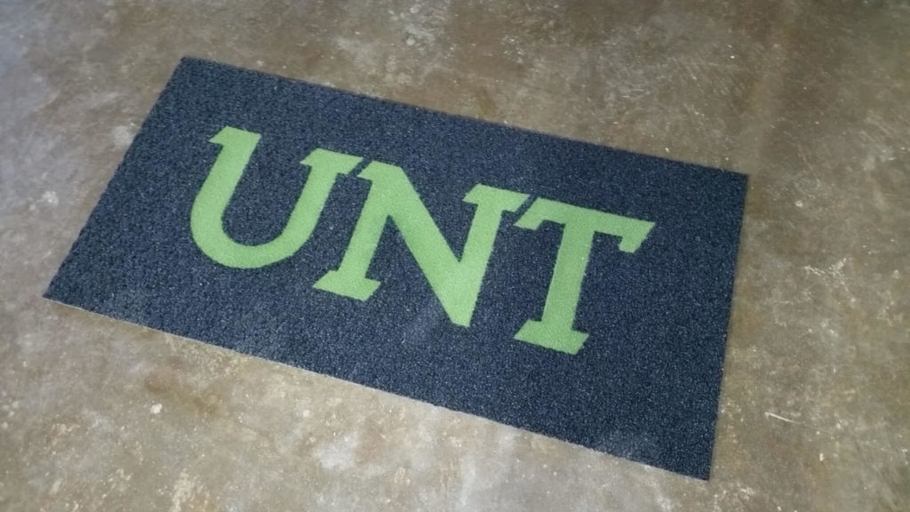 Custom Carpet Green UNT Letters ENSO