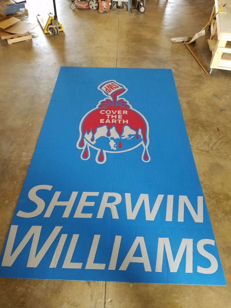 Custom Carpet Sherwin Williams Cover the Earth Logo ENSO