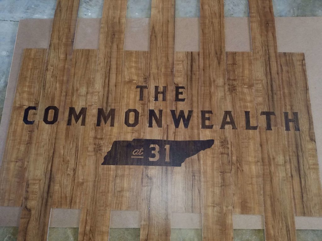 Custom LVT Floor The Commonwealth at 31 Logo ENSO