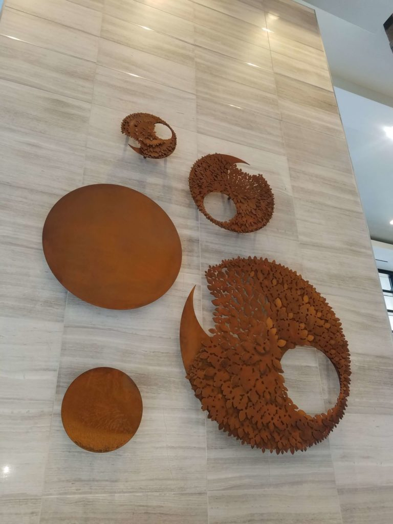Rust Patina Metal Circle Textured Art Close View ENSO