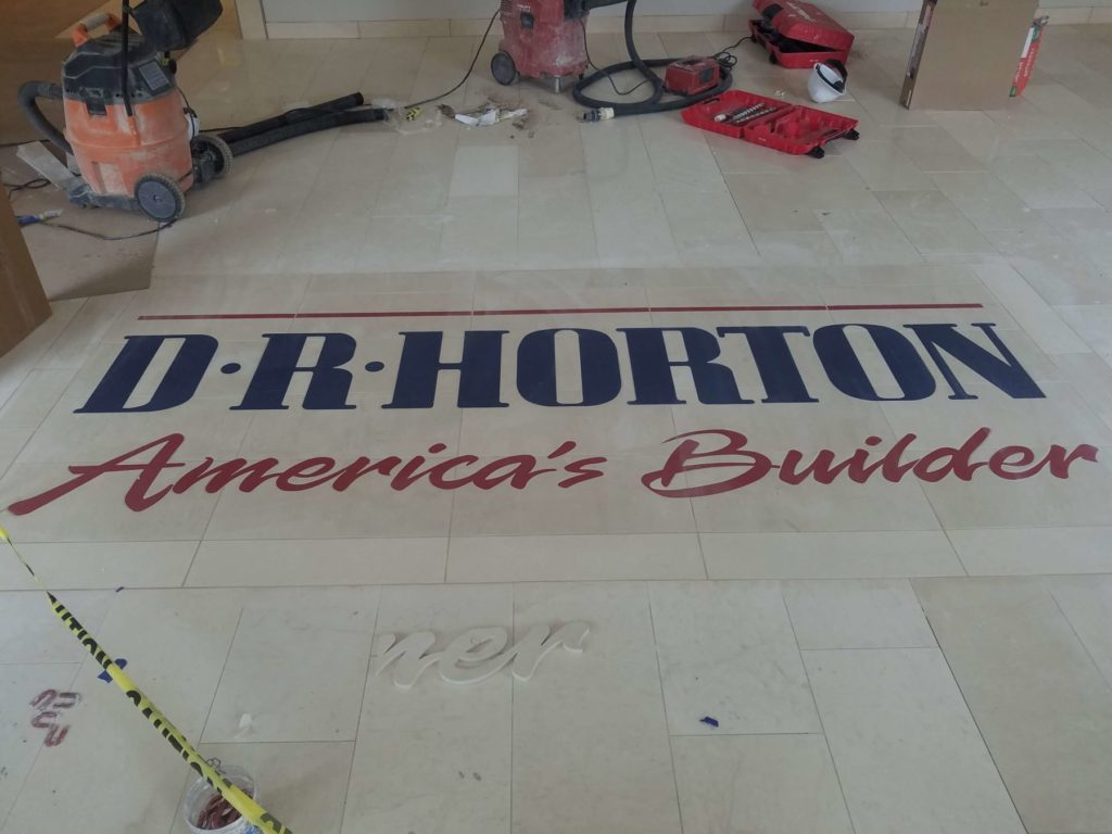 Stone Medallion Inlay D R Horton Sign During Installation ENSO