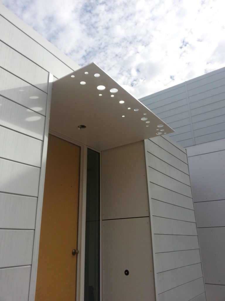 Contemporary Fabricated Steel Awning With Circles ENSO