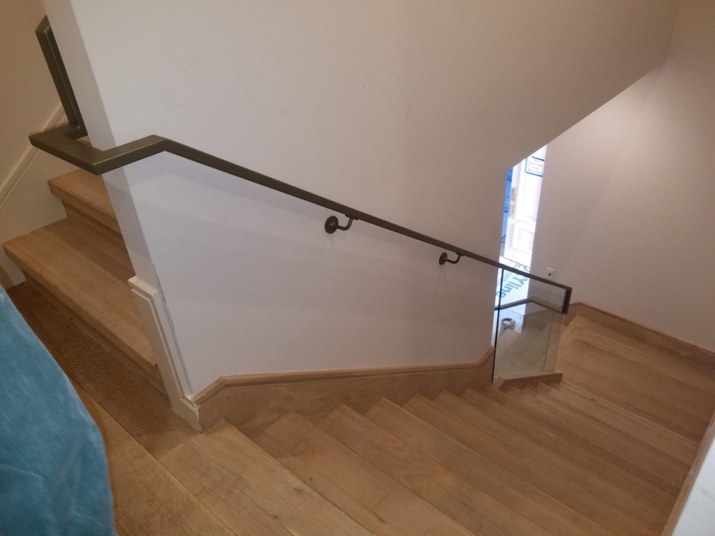 Glass and Metal Stairway Railing Between Floors ENSO