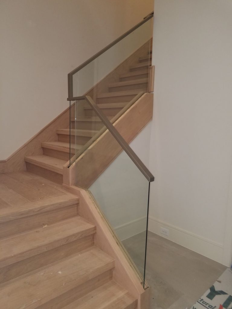 Glass and Metal Stairway Railing During Installation ENSO